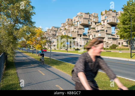 Montreal, Canada - 9 June 2017: Cruise Ship passing in front of Habitat 67 housing complex in the Old Port of Montreal - Stock Photo