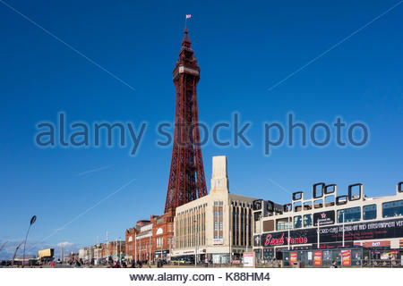 The prominent and famous Blackpool Tower stands over the promenade at the famous seaside resort on the Fylde Coast, - Stock Photo