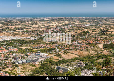 View over parts of San Marino, the Emilia-Romagna region of Italy and the Adriatic coast from the summit of Mount - Stock Photo