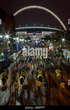 Long exposure photo of Bradford City and Swansea City fans leaving Wembley Stadium after the League Cup Final, 24th - Stock Photo