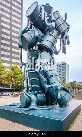 Netherlands, South Holland, Rotterdam, Maritime District, sculpture of oil drums and human figures, titled 'Cascade' - Stock Photo