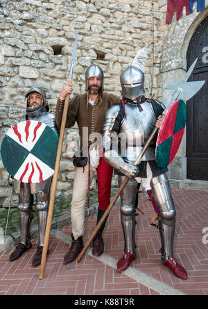 San Marinis dressed and performing in period costumes during the annual Medieval Days Festival held in San Marino. - Stock Photo