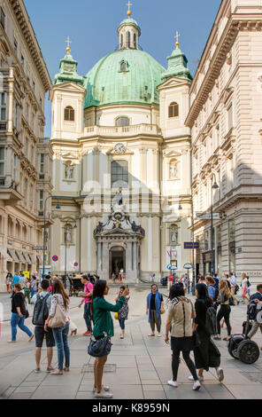 VIENNA, AUSTRIA - AUGUST 28: Tourists at the baroque Peterskirche church in Vienna, Austria on August 28, 2017. - Stock Photo