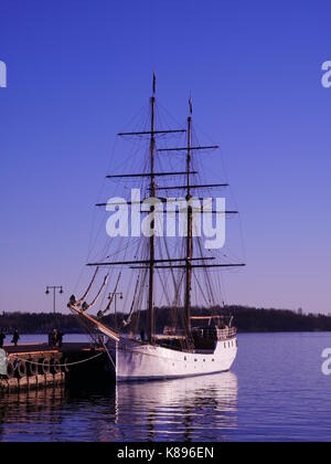 Tall ship S/V Legend at the jetty on a pleasant evening in Oslo, Norway - Stock Photo