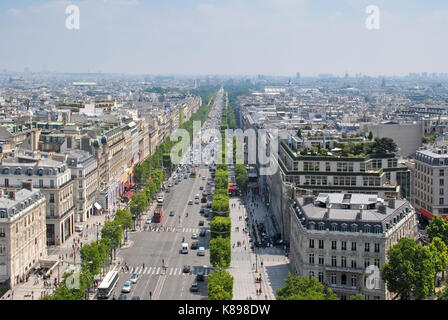 Panorama of Paris on the Champs Elysees towards the Louvre from the observation deck of the arc de Triomphe. - Stock Photo