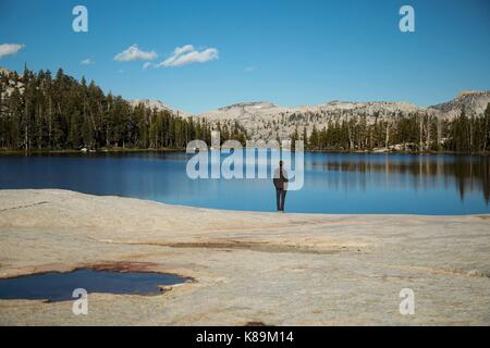 Yosemite National Park, California, USA. 13th Sep, 2017. Will Brunker looking over Cathedral Lakes in Yosemite National - Stock Photo