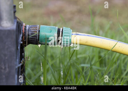 The connection is leaking water - Stock Photo