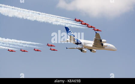 Airbus A380 flys at Farnborough Airshow for the first time with red Arrows Escort - Stock Photo