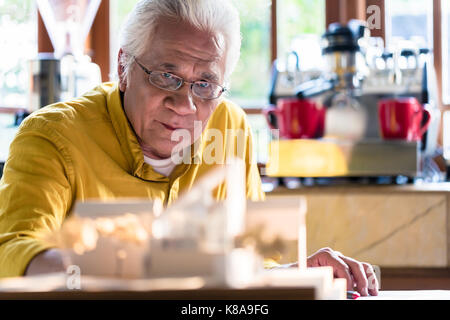 Asian architect expert studying an innovative residential projec - Stock Photo