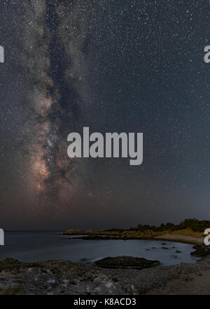 Night sky with Milky Way setting to the Libyan sea - Stock Photo