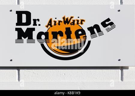 Merignac, France - June 5, 2017: Dr. Martens logo on a wall. Dr. Martens is a British footwear and clothing brand - Stock Photo