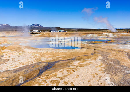 Steaming mud cauldrons and fumaroles at Námafjall Hverir geothermal area, Iceland - Stock Photo
