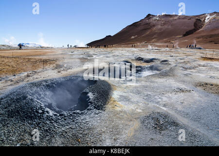 Steaming fumaroles at Námafjall Hverir geothermal area, Iceland - Stock Photo