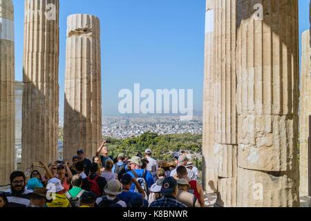 Acropolis of Athens, tourists walking through the passage of Propylaea, Athens, Greece, Sep 2017 - Stock Photo