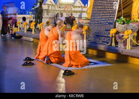 Monks praying at Wat Saket (The Golden Mount) in Bangkok, Thailand - Stock Photo