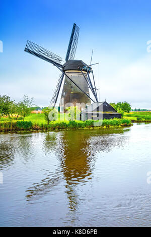 Windmill in a Holland landscape. - Stock Photo