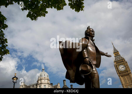 The statue to Liberal politician David Lloyd George which stands in Parliament Square, below the Elizabeth Tower - Stock Photo