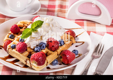 Belgian waffles with whipping cream - Stock Photo