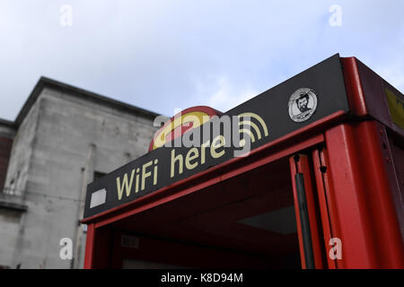 Wifi here sign on public  phone box - Stock Photo
