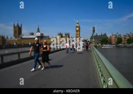 Anti Terroisim barrier installed on Westminister bridge to protect pedestrians walking to the Houses of Parliament - Stock Photo