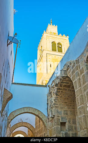The minaret and arches of the medieval Ksar Mosque, located in medina, Tunis, Tunisia. - Stock Photo