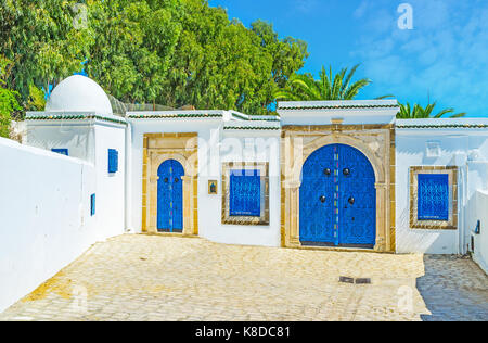 Historic Arabic mansion in Sidi Bou Said with traditional white walls and bright blue doors, decorated with islamic - Stock Photo