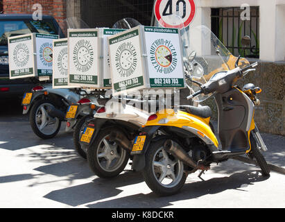 Belgrade, Serbia - June 11, 2017: Scooters with food delivery boxes, for Botako pizza home delivery service, parked - Stock Photo