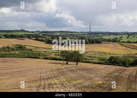 View across Autumn fields with Emley Moor transmission mast in the background - Stock Photo