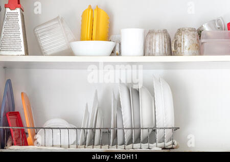 Clean dishes are in the kitchen cupboard. - Stock Photo