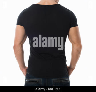 Rear view midsection of man wearing blank black tshirt standing against white background - Stock Photo