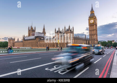 London Taxis on Westminster Bridge, Palace of Westminster, Houses of Parliament, Big Ben, City of Westminster, London, - Stock Photo