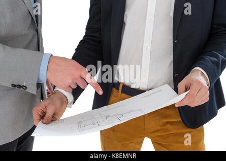 Real-estate agent showing house plans to a businessman. - Stock Photo
