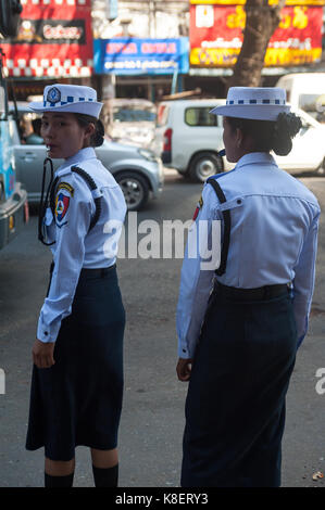26.01.2017, Yangon, Yangon Region, Republic of the Union of Myanmar, Asia - Two female traffic police officers stand - Stock Photo