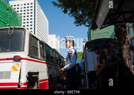 27.01.2017, Yangon, Yangon Region, Republic of the Union of Myanmar, Asia - A female traffic police officer stands - Stock Photo