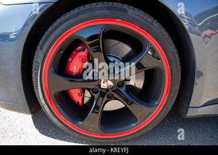 BADAJOZ, SPAIN - MARCH 14, 2015: Ferrari Car show at Badajoz  Detail image showing the rim with porsche shield - Stock Photo
