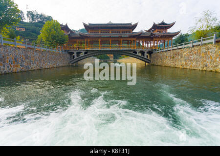 Low angle view of the traditional wooden bridge at Xijiang Miao ethnic minority village in Guizhou, China - Stock Photo