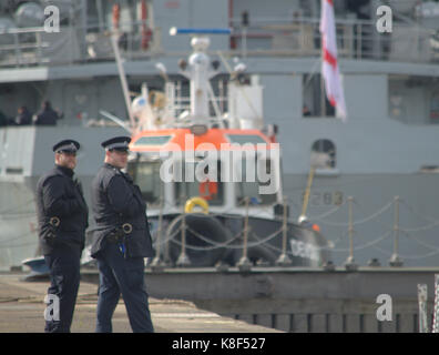 Met Police providing security to warships heading to the DSEi event in London UK - Stock Photo