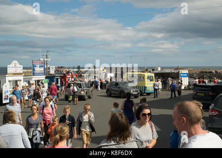 August Bank Holiday visitors at Seahouses harbour, Northumnberland, England - Stock Photo