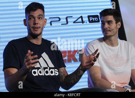 Madrid, Spain. 19th Sep, 2017. Spain's national basketball team players Juancho (R) and Willy Hernangomez speak during the presentation of the video game NBA 2K18 in Madrid, Spain, on 19 September 2017. Credit: Victor Lerena/EFE/Alamy Live News Stock Photo