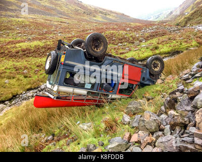 Near Ambleside, The Lake District, UK. 19th Sep, 2017. An overturned Land Rover on its roof after losing control - Stock Photo