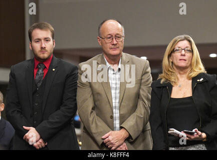 Washington DC, USA. 19th Sep, 2017. Family members who lost loved ones in the two separate collisions with the USS Fitzgerald and USS John S. McCain that resulted in the loss of 17 US Sailors, stand as they are introduced prior to the beginning of testimony before the US Senate Committee on Armed Services on 'Recent United States Navy Incidents at Sea' on Capitol Hill in Washington, DC on Tuesday, September 19, 2017. Credit: Ron Sachs/CNP /MediaPunch Credit: MediaPunch Inc/Alamy Live News Stock Photo