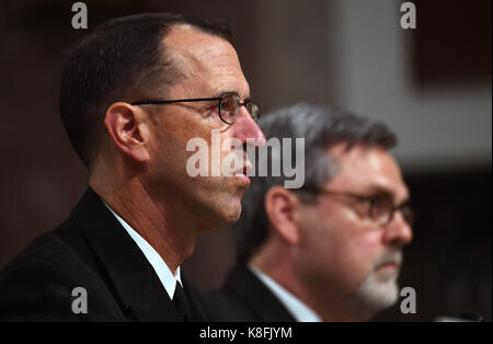 Washington, USA. 19th Sep, 2017. Chief of Naval Operations Admiral John Richardson (L) attends a hearing on recent U.S. Navy incidents before Senate Armed Services Committee on Capitol in Washington, DC, the United States, on Sept. 19, 2017. Top leaders of the U.S. Navy were urged to do better on Tuesday as they appeared before the Senate hearing over a series of deadly ship collisions involving the Pacific fleet. Credit: Yin Bogu/Xinhua/Alamy Live News Stock Photo