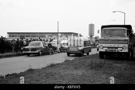 Archive black and white pictures of a car crash between a Cortina and a mini van from the 1960s England with people - Stock Photo