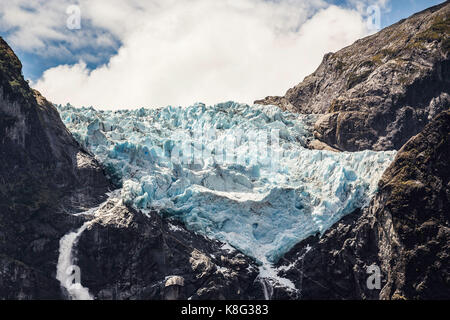 Waterfall and glacier at edge of mountain, Queulat National Park, Chile - Stock Photo