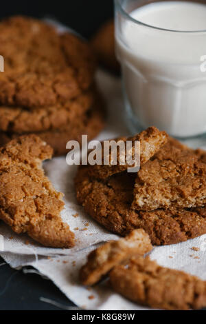 High angle view of eaten cookies and milk on table - Stock Photo