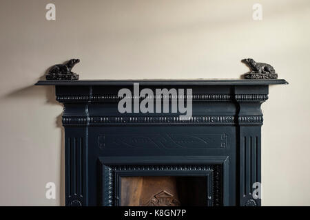 Victorian bedroom cast iron fireplace with two Sussex iron dogs either side - Stock Photo