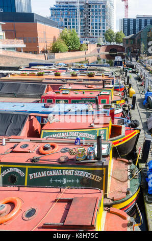 Colourful narrow boats moored in Gas Street Basin, Birmingham - Stock Photo