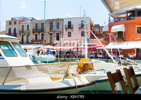 Restaurants and cafes in the old Venetian Harbor of Rethymno. Crete, Greece - Stock Photo