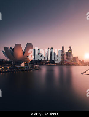 Art Science Museum and the surrounding skyline during golden hour - Stock Photo