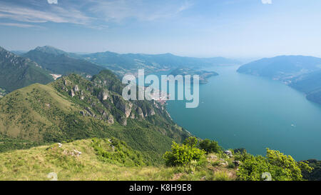 Panorama view on Lake Iseo and surrounding mountains from Mount Trentapassi in afternoon sun, Lombardy, Italy - Stock Photo